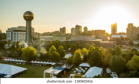 Aerial view of a Knoxville city park morning preparing for an event and city skyline