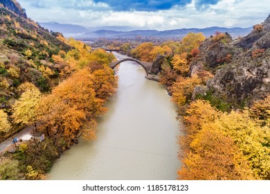 Aerial view of Konitsa old bridge and Aoos River an autumn day, Greece.