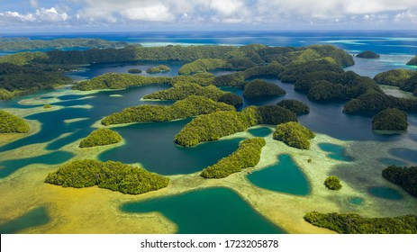 Aerial view of Koror island, many lush green islets and blue lagoons, azure crystal clear waters of western Pacific Ocean - landscape panorama of Micronesia from above, Palau