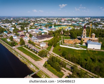 Aerial view of Kostroma city on bank of Volga River overlooking Temple Complex of Kostroma Kremlin during reconstruction, Russia