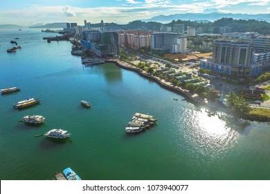 Aerial view of Kota Kinabalu city with street,buildings & sea in Kota Kinabalu,Sabah.Kota Kinabalu City is hub for islands,resorts,award winning sunsets & Mount Kinabalu.