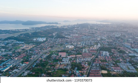 Aerial view of Kota Kinabalu City, Sabah Malaysia. View from Cybercity Apartment, Kepayan, Kota Kinabalu, Sabah. Borneo. Malaysia. footage view of airplane at the airport and cars by the road.