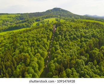 Aerial view of Krizova hora with Stations of the Cross in Jiretin pod Jedlovou, Luzicke hory, Czech republic, European union. Jedlova mountain in behind.
