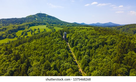 Aerial view of Krizova hora with Stations of the Cross in Jiretin pod Jedlovou, Luzicke hory, Czech republic, European union. Jedlova mountain in behind.