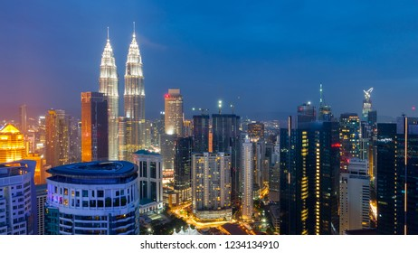 aerial view of Kuala Lumper, cityscape skyline at twilight.