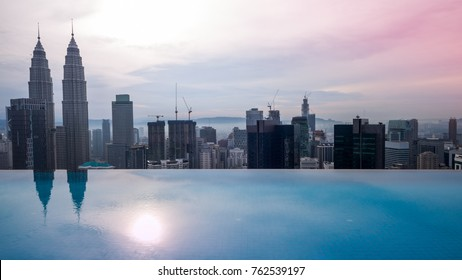 aerial view of Kuala Lumper skyline with roof top pool at sun rise