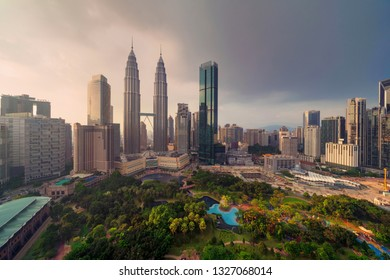 Aerial view of Kuala Lumpur Downtown, Malaysia. Financial district and business centers in smart urban city in Asia. Skyscraper and high-rise buildings at sunset.