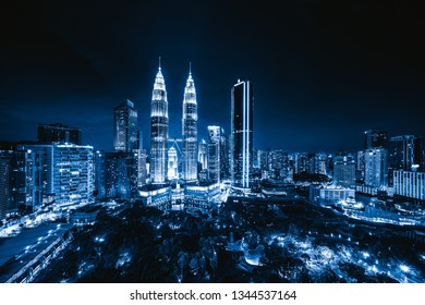 Aerial view of Kuala Lumpur Downtown, Malaysia. Financial district and business centers in smart urban city in Asia. Skyscraper and high-rise buildings at night.