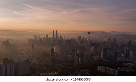 An aerial view of Kuala Lumpur skyline during beautiful sunrise. Captured using a drone.