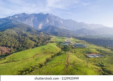 aerial view of Kundasang Sabah landscape and Mount Kinabalu at background during morning.