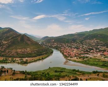 Aerial view of Kura and Aragvi rivers confluence near the old Georgian town Mtskheta. Panorama of unesco town Mtskheta from Jvari church near Tbilisi in Georgia