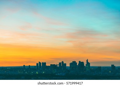 Aerial view of La Defense in Paris at sunset. Panoramic view of Paris and of the modern area on the west side of the city. Minimalist composition with a wide empty space to add text