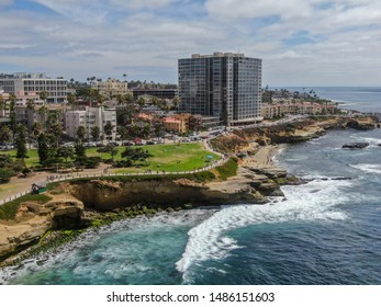 Aerial view of La Jolla Cove, small picturesque cove and beach surrounded by cliffs, San Diego, California. Protected marine reserve, popular with snorkelers and swimmers. Travel destination.