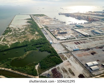 Aerial view of Laem Chabang Port construction site, Chonburi Province, an important logistic site of Thailand. Container cargo freight ships sit idle with working crane in the shipyard.
