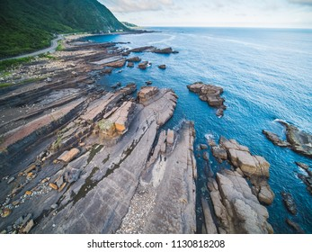 Aerial View of Lailai Coast Geological Area - Northeast and Yilan Coast National Scenic Area. Coast landscape birds eye top view use the drone, shot in Gongliao District, New Taipei, Taiwan.