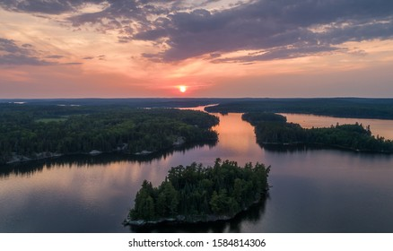 An aerial view of a lake in the boreal forest of Northwest Ontario, Canada.