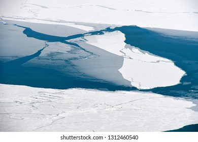 aerial view of Lake Michigan with blue water and ice
