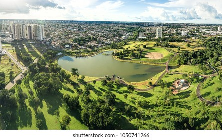 Aerial view from the lake of Parque Das Nacoes Indigenas, the biggest park of the city, with a huge green area of nature in Campo Grande MS, Brasil.