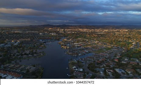 Aerial view of lake San Marcos in north county San Diego California with a beautiful cloudscape and dynamic lighting