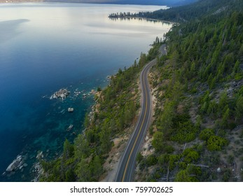 Aerial view of Lake Tahoe and the road around it.