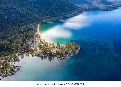 Aerial View of Lake Tahoe Shoreline with Mountains and Turquoise Blue Waters