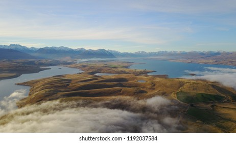 Aerial view of Lake Tekapo and Lake Alexandrina with low cloud, New Zealand