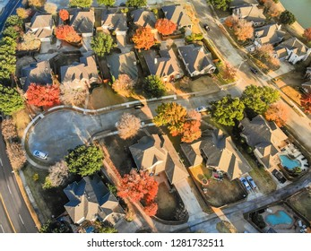 Aerial view lakefront neighborhood with cul-de-sac (dead-end) street near Dallas, Texas. Morning autumn season with colorful fall foliage leaves