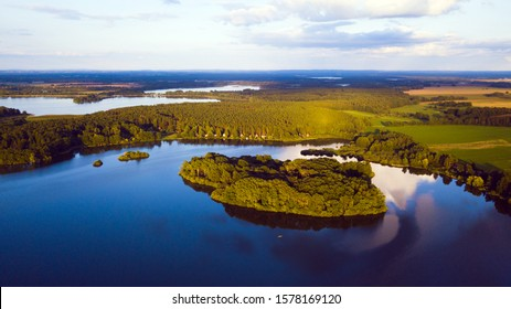 Aerial view of lakes in South Bohemia. Dvoriste pond with island in the evening. Popular recreational region, Czech republic, European union. - Shutterstock ID 1578169120
