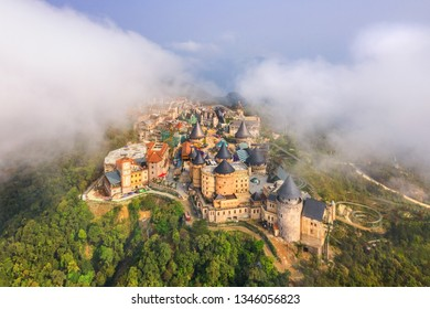 Aerial view of landscape is castles covered with fog at the top of Bana Hills, the famous tourist destination of Da Nang, Vietnam