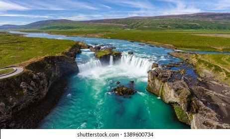 Aerial view landscape of the Godafoss famous waterfall in Iceland. The breathtaking landscape of Godafoss waterfall attracts tourist to visit the Northeastern Region of Iceland.