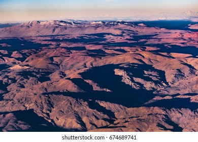 Aerial view landscape scene of andes mountains from window plane