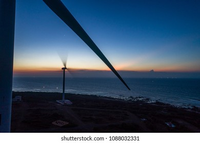 Aerial view of landscape with Turbine Green Energy Electricity, Windmill for electric power production, Wind turbines generating electricity  on Phu Qui island, Binh Thuan, Vietnam.