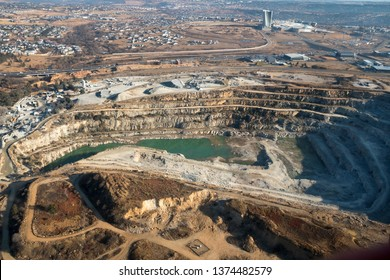 Aerial view of a large cement quarry and surrounding area in Midrand.
