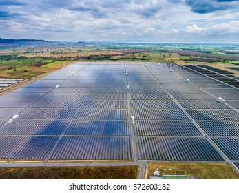 Aerial view of large farm of solar panels producing electricity.