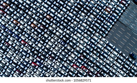 Aerial view of a large number of stopping cars.