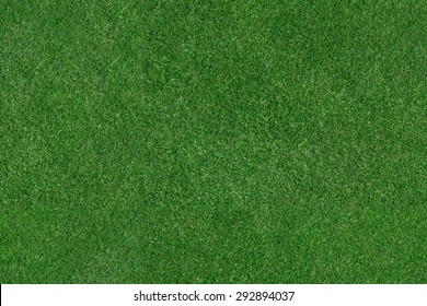 An aerial view of a large patch of some freshly cut, healthy, green grass. Image is ready to be tiled to create a much larger image or higher resolution background.