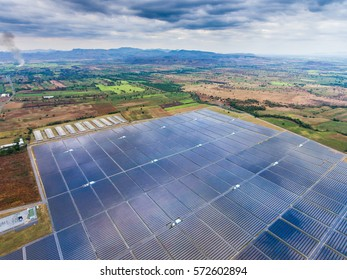 Aerial view of large solar farm, panels for electricity production. Renewable, clean, green, alternative energy for sustainability development.