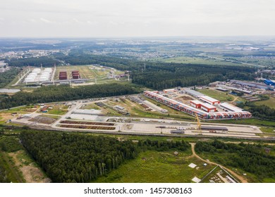 Aerial view of large warehouse. Logistics center in industrial city zone from above. Drone picture
