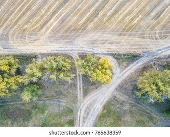Aerial view of large wheat fields after harvesting