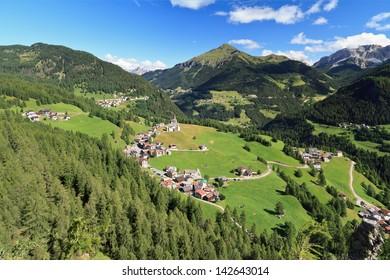 aerial view of Laste village and Cordevole valley from Sass de Rocia, Italian Dolomites