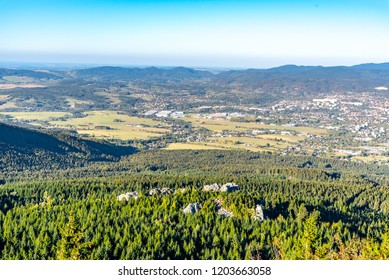 Aerial view of Liberec city and Jizera Mountains from Jested Mountain on sunny summer evening. Czech Republic.