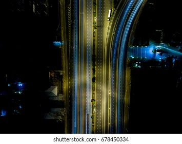 Aerial view light trails on motorway highway at night, long exposure abstract. shot from drone