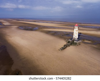 Aerial view of the lighthouse on the beach at Talacre in North Wales.