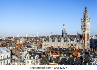 Aerial view of Lille, the roofs, the belfry of the Hotel de Ville, the blue sky. FRANCE - November 2016.