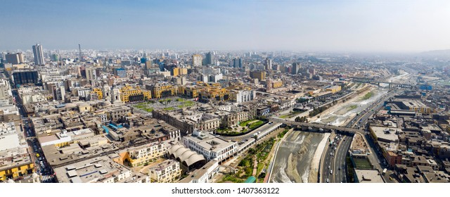 "Aerial view of Lima main square, government palace of Peru and Rimac river. Panoramic cityscape with ""Plaza de Armas"" in the historic center of Lima."