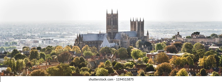 An aerial view of Lincoln Cathedral in autumn colour