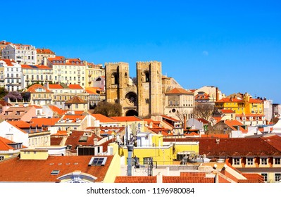 Aerial view at Lisbon downtown with famous Se cathedral and red tiled roofs in Lisbon, Portugal.