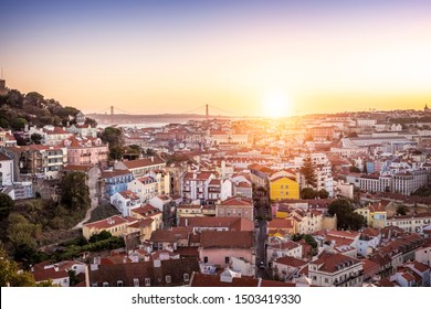 Aerial view of Lisbon in Portugal at sunset as seen from Miradouro da Graca at Alfama Neighborhood.