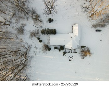 Aerial view of a little house among the trees