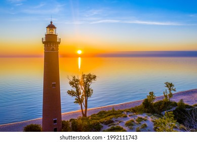 Aerial view of Little Sable Point Lighthouse as the sun sets over Lake Michigan, located just south of Ludington near Mears, Michigan